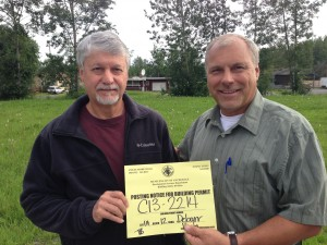 Dale Fick and Kevin Aleshire holding the building permit
