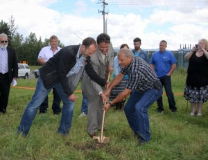 Jassen Michael from Bauer Construction, Kent Redfearn, Lead Pastor, and Kevin Aleshire, MCA Project Manager break the ground for the youth facility